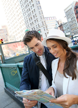 A Young Couple looking at a Subway Map